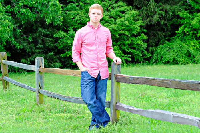 Portait Photography young man by fence